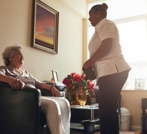 Caregiver talking to the elderly